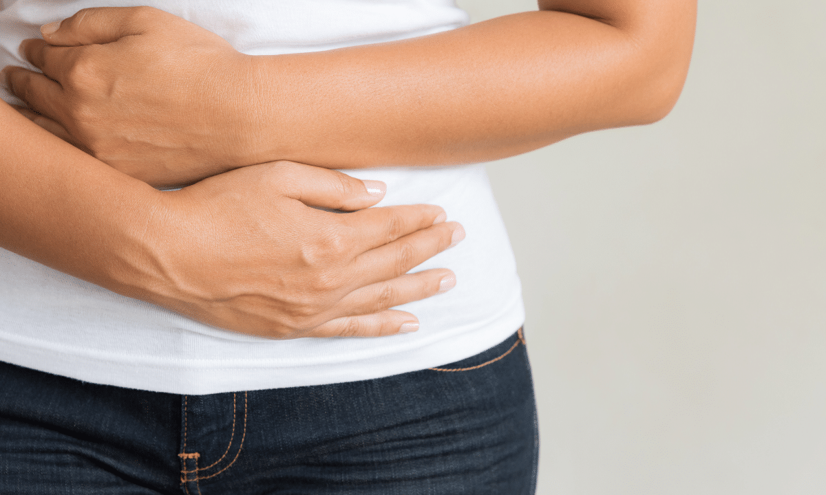 Perimenopause Constipation: woman holding stomach